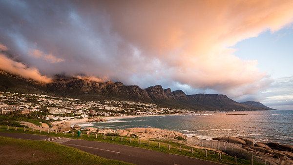 Sunset at Camps Bay with cloud over the 12 Apostles mountains