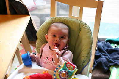 She seems more excited by the spoon.