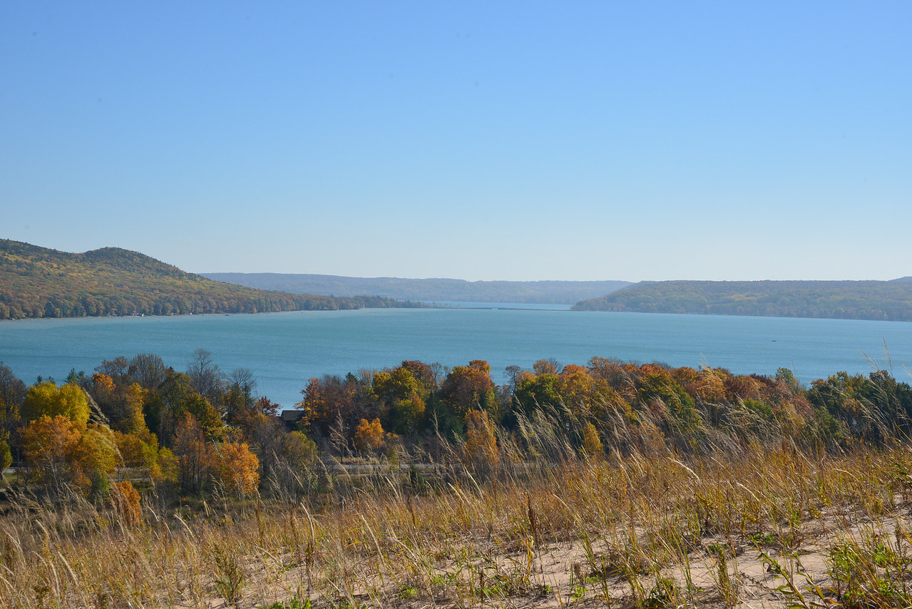 "From the Dune Climb, Little Glen Lake mid-photo, Big Glen in background, ""Narrows"" bridge/M-22 in mid-photo"