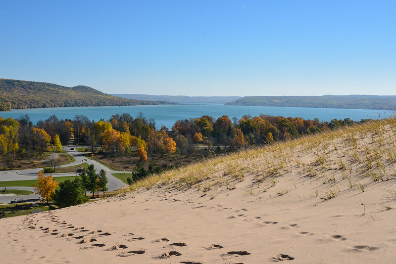 """Sleeping Bear Dunes National Lakeshore, Dune Climb, fall colors, Little Glen Lake in background, Big Glen in distant background, M-22 is the road that runs across the """"narrows"""" bridge, center of photo"""