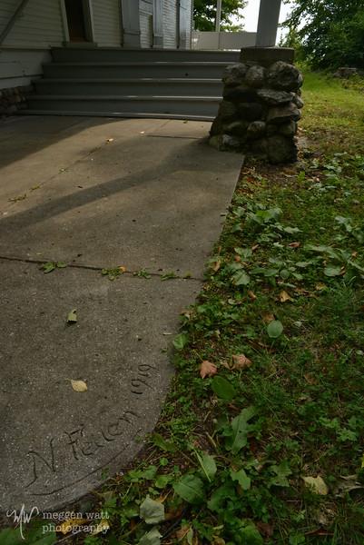 """Katie Shepard - """"N Felten 1919"""" on southwest sidewalk corner"""