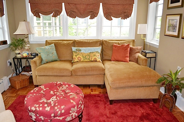 One of our many design projects! Featured is our compact yet cozy 1296 sectional from LEE Industries with an ottoman in the beautiful Blossom Red fabric.