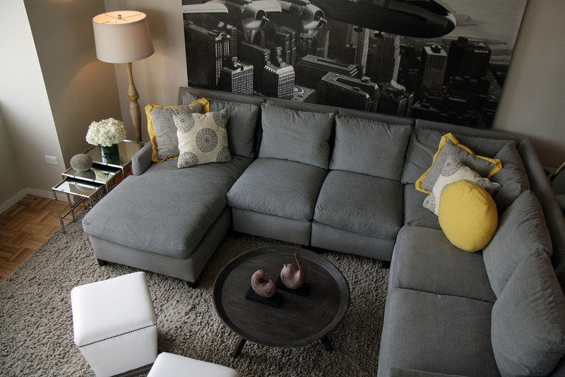 A Bird's Eye View!<br /> This beautiful Living Room features a perfectly scaled Lee Industries Sectional (1296 series) with big cozy down unwrapped seats upholstered in Lucas Mist fabric. Custom Lee pillows:  Luna Smoke and  Glyn Linen Lemon accent the monochromatic color scheme.