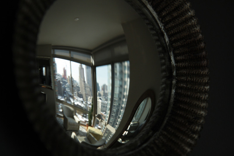 Reflections in the convex mirror add more sparkle to the room.