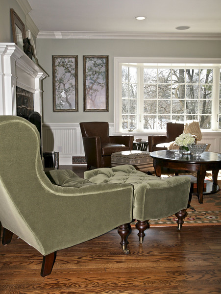 Warm and Inviting<br /> Notice the profile of this glamorous tufted chair and ottoman as you enter the room.  Lee Industries (1744) chair and ottoman upholstered in a grade M fabric, Flanders Moss with black walnut finish on the legs.