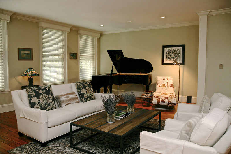 The other focal point, the baby grand sets off the living area and provides a feeling of togetherness and gregarious charm.