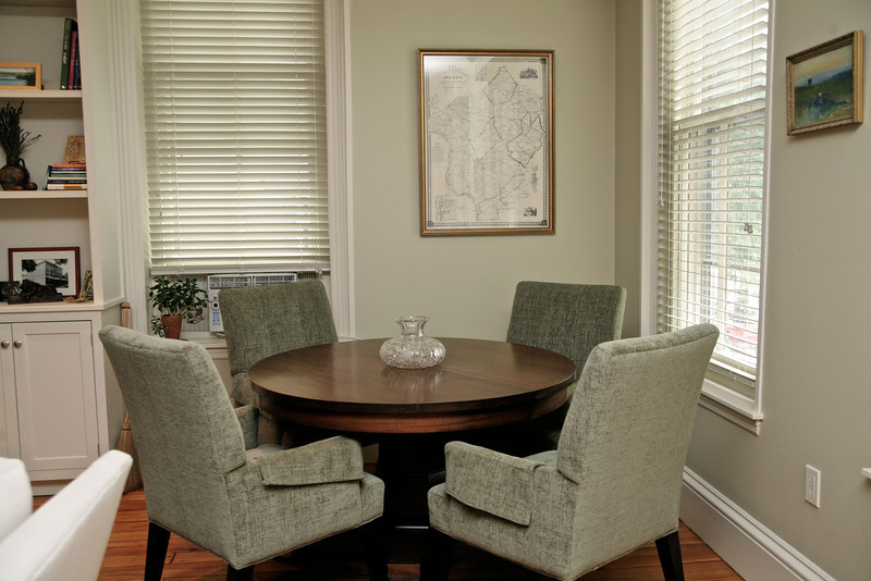 Plump upholstered furniture in neutral tones are paired with a pleasantly imperfect wood finish table.  The Lee Industries chairs (5567-4) are upholstered in Chet Sage and provide an ideal dining/conversation area.