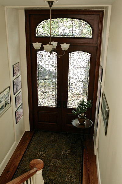 Looking down on the leaded glass doors of the entrance to the apartment.