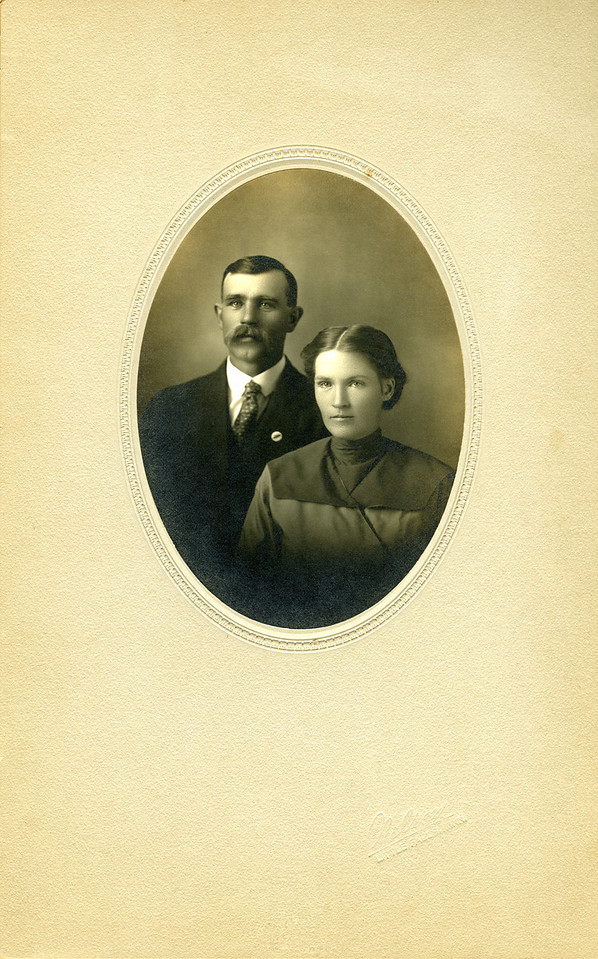 Mary Elizabeth Nelson to Ernie James 5-1-1907, Pierz, MN  (I found another photo that said this was NOT their wedding photo) -  Mary Nelson James  12-17-1885 to 10-25-1973, Ernie (Ernest) James  9-21-1878 to 5-18-1949  Guess what, at 200% increase, I can tell that Ernie's button is insect-most likely a Honey Bee.  How cool is that?