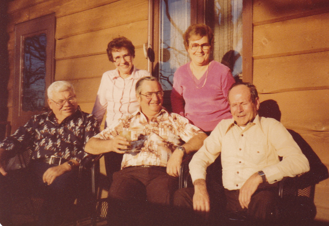 Russell, Ruth, Allen, Lorna, Byron Killmer.  Photo taken on porch of the Eagle Lake Home.  Plus this was AFTER living in the 'green' house in Osseo, so what you see is the addition to the original Eagle Lake house.  What year is this?