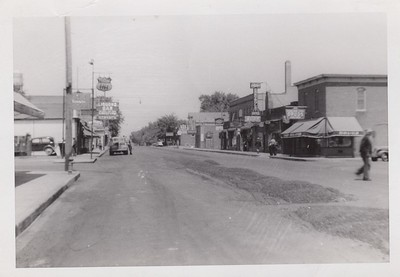 Central Avenue, Osseo  Looking North.   Bills bar on left/front.