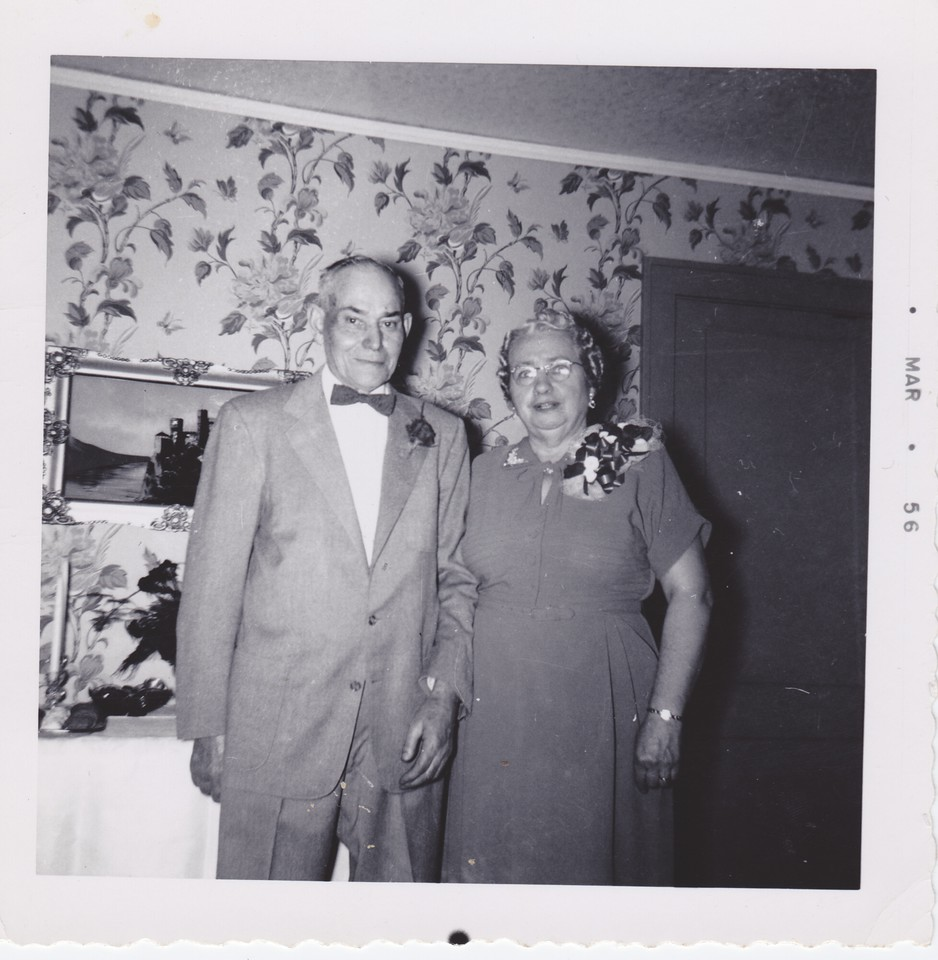 Lou and Mary Dodds Killmer, photo dated March 1956, probably because it was reprinted then.  Osseo home (door leads upstairs). As this is the 25th wedding anniversary, November 24,1940.  Wedding was 11-24-1915.