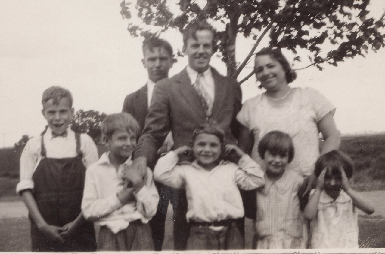 Aug, 1930  -  (Middle) Grandmother Mary Killmer's cousin Ralph, and she is on the right.  Children are Byron, Allen, Russell, Lorna, Ruth
