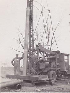 Dad (Allen Killmer, Sr) says the man on the left is Ed P. Killmer, his Uncle.  No name for the fellow on the right.  Based on all the pipes, left front, this could be well drilling in/for Osseo city water.  Date on photo was only 1918.