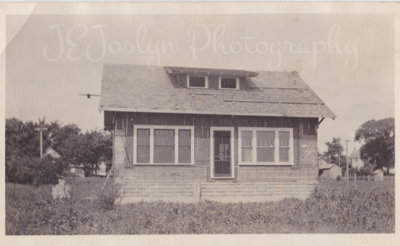 Mary and Lou Killmers house, 1st Avenue, Osseo, before front porch was added.  Probably 1918.   2012 the house was torn down, entire block, Main Street side and 1st Avenue side, replaced by apartments.