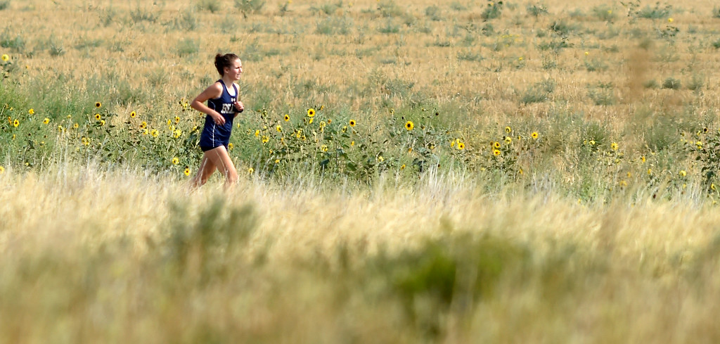 . BROOMFIELD, CO: August 17:  Jenna Baker, of Palmer Ridge, wins the 2-mile during the Legacy Lightning Invitational cross country race  in Broomfield on August 17, 2018. (Photo by Cliff Grassmick/Staff Photographer).