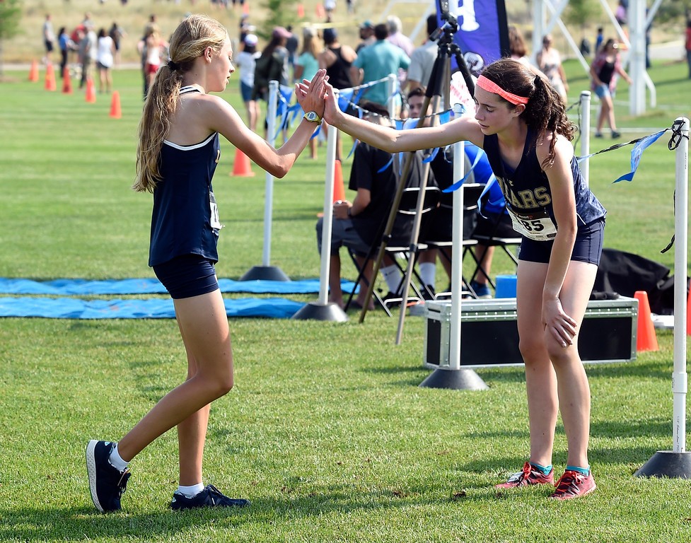 . BROOMFIELD, CO: August 17:  Abby Jones, left, who was second, congratulates winner, Isabella Prosceno, of Palmer Ridge, during the Legacy Lightning Invitational cross country race in Broomfield on August 17, 2018. (Photo by Cliff Grassmick/Staff Photographer).