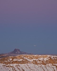 Setting moon in eclipse over Cabezon Peak, New Mexico, December 2011.
