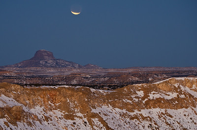 Eclipse at moonset over Cabezon Peak, New Mexico, December 2011.