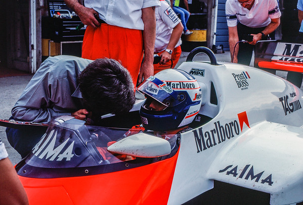 Alain Prost in discussion with his engineer