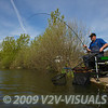 Angler Will Raison plays a carp hooked on method feeder runnimng line tackle. Middle Lake, Gold Valley, Aldershot, England. © 2009 Brian Gay