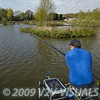 Angler Will Raison plumbing the depth next to an island on Gold Valley's Middle Lake. © 2009 Brian Gay