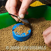 Using a Garbolino speed mould step 3. Push the feeder onto the the bait in the mould. © 2009 Brian Gay