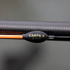 Close-up of the bristle, body and part of the stem of a KC Carpa 2 4x12 gr. pole float with an orange tip. Shows side eye and rubber at top of the stem. © 2011 Brian Gay