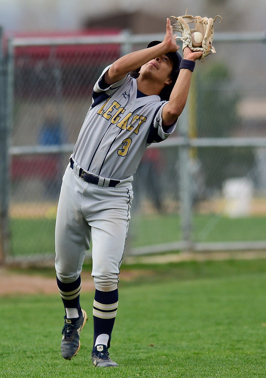 . BOULDER, CO - APRIL 16:Legacy High School\'s Josh Maestas (No. 3) makes a catch for an out in the game against Fairview High School in Boulder on April 16, 2019. (Photo by Matthew Jonas/Staff Photographer)