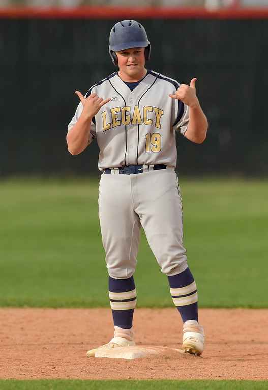 . BOULDER, CO - APRIL 16:Legacy High School\'s Henry Kisselman (No. 19) celebrates hitting a double against Fairview High School in Boulder on April 16, 2019. (Photo by Matthew Jonas/Staff Photographer)