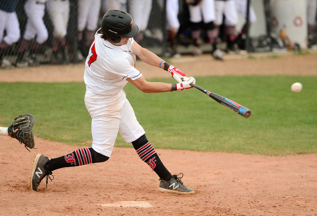 . BOULDER, CO - APRIL 16:Fairview High School\'s Adam Moser (No. 17) hits a triple against Legacy High School in Boulder on April 16, 2019. (Photo by Matthew Jonas/Staff Photographer)