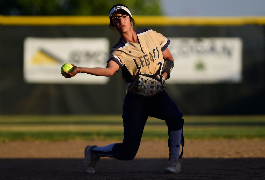 . LOVELAND, CO - SEPTEMBER 27:Legacy High School\'s Morgan Hernandez-Belew (No. 3) throws to first base in the game against Loveland High School in Loveland on Sept. 27, 2018. (Photo by Matthew Jonas/Staff Photographer)