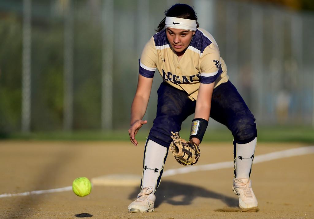 . LOVELAND, CO - SEPTEMBER 27:Legacy High School\'s Kaitlyn Strachan (No. 5) snags a ground ball hit by Loveland High School in Loveland on Sept. 27, 2018. (Photo by Matthew Jonas/Staff Photographer)