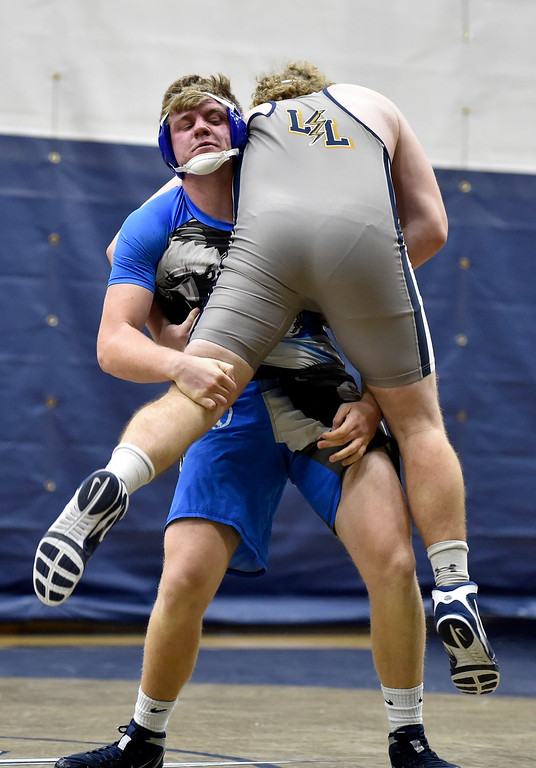 . BROOMFIELD, CO - JANUARY 09, 2019: Broomfield High School\'s Bryant Walker takes down Josh Beaver during a 220 -pound wrestling match during a meet against Legacy on Wednesday in Broomfield. More photos: BoCoPreps.com (Photo by Jeremy Papasso/Staff Photographer)
