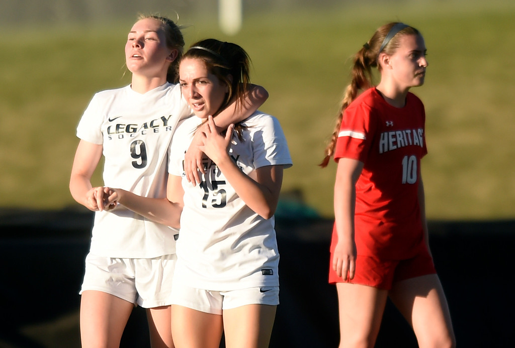 . Legacy High School\'s Nora Spuler, left, congratulates Alyssa Johnson on a goal during a CHSAA first round playoff game against Heritage on Tuesday at the North Stadium in Westminster. More photos: BoCoPreps.com Jeremy Papasso/ Staff Photographer 05/08/2018