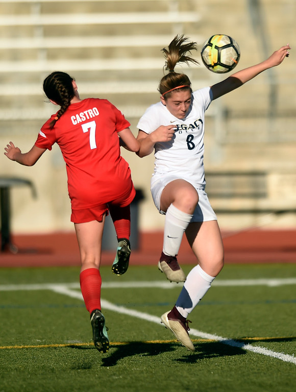 . Legacy High School\'s Analisa Carmosino heads the ball over Maddie Castro during a CHSAA first round playoff game against Heritage on Tuesday at the North Stadium in Westminster. More photos: BoCoPreps.com Jeremy Papasso/ Staff Photographer 05/08/2018