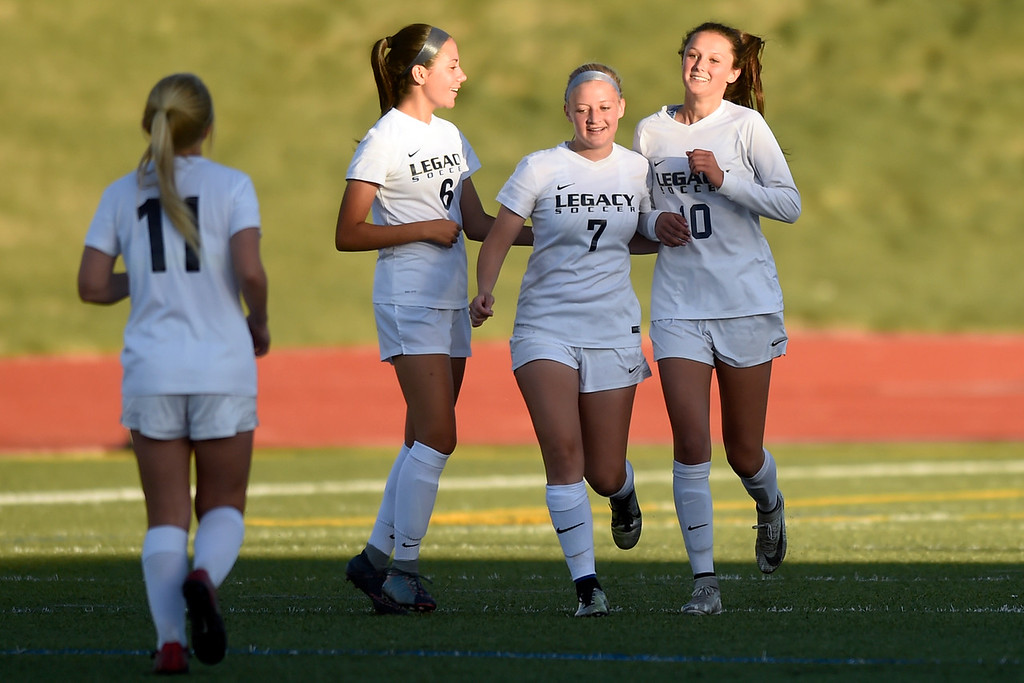 . Legacy High School\'s Gracie Armstrong, right, is congratulated on a goal by teammates during a CHSAA first round playoff game against Heritage on Tuesday at the North Stadium in Westminster. More photos: BoCoPreps.com Jeremy Papasso/ Staff Photographer 05/08/2018