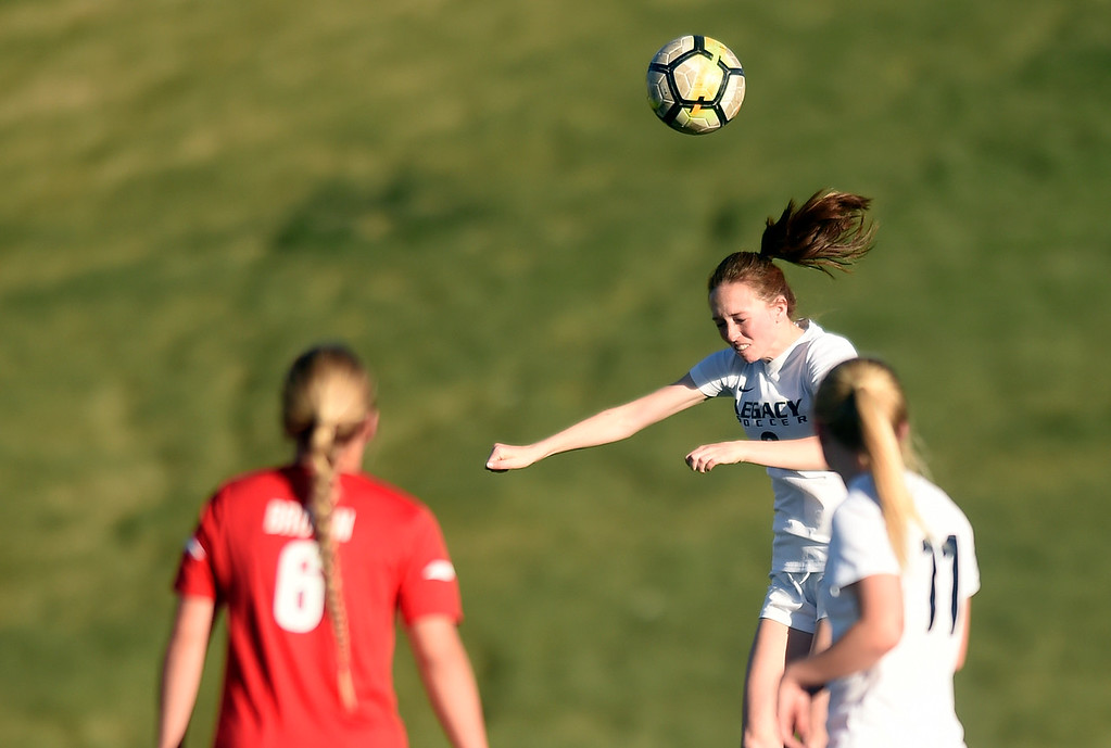 . Legacy High School\'s Sabrina Hall heads the ball during a CHSAA first round playoff game against Heritage on Tuesday at the North Stadium in Westminster. More photos: BoCoPreps.com Jeremy Papasso/ Staff Photographer 05/08/2018