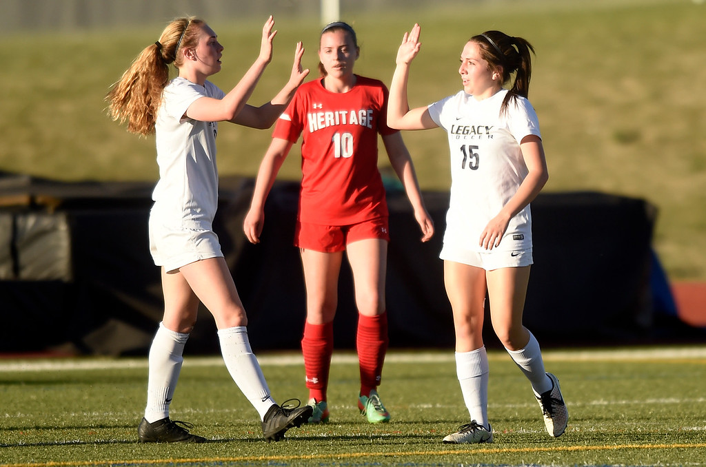 . Legacy High School\'s Nora Spuler, left, congratulates teammate Alyssa Johnson on a goal during a CHSAA first round playoff game against Heritage on Tuesday at the North Stadium in Westminster. More photos: BoCoPreps.com Jeremy Papasso/ Staff Photographer 05/08/2018