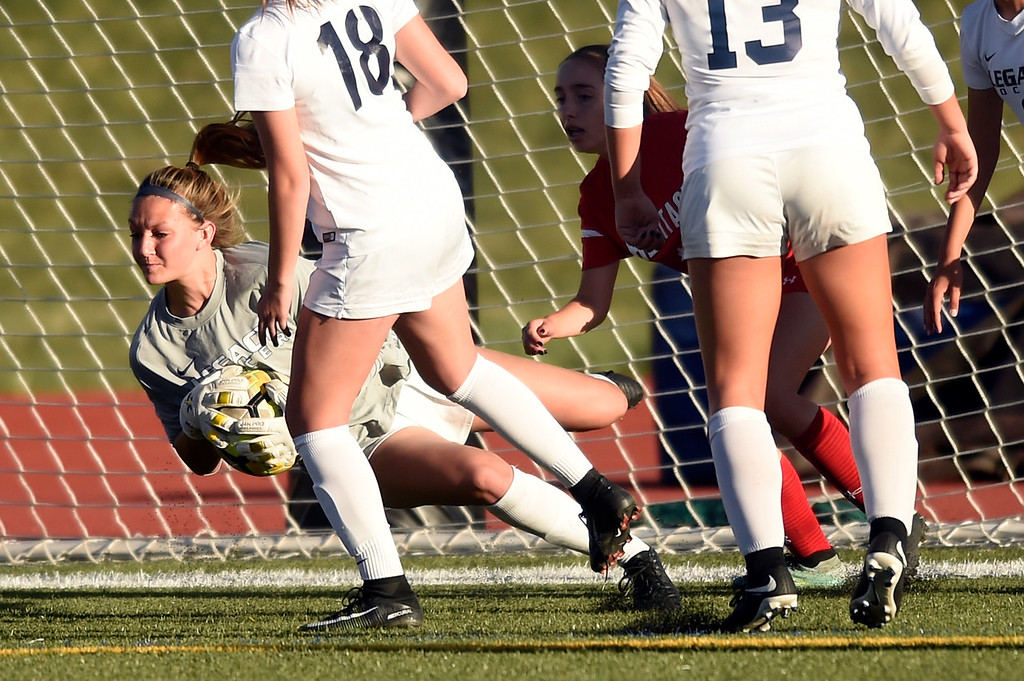 . Legacy High School goalkeeper Makenna Gottschalk makes a save during a CHSAA first round playoff game against Heritage on Tuesday at the North Stadium in Westminster. More photos: BoCoPreps.com Jeremy Papasso/ Staff Photographer 05/08/2018