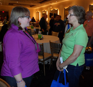 Mary Ann Turner-DeJesus (left) speaks with one of her heroes, Fuller Center co-founder Linda Fuller Degelmann.