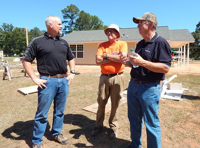 From left: Stihl's Roger Phelps, Fuller Center President David Snell, and North American Retail Hardware Association President Bill Lee on the final day of the 2016 Millard Fuller Legacy Build.