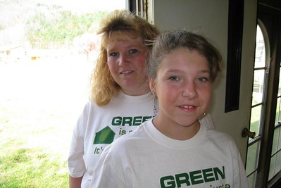 Brittnay with mother, Trish Simmons, standing inside their old mobile home. lcf