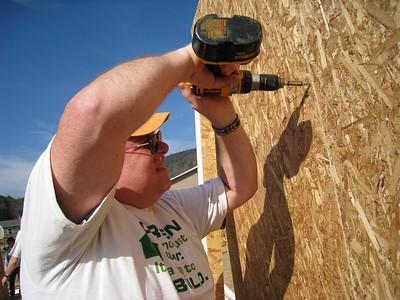 Volunteer screws panels together. lcf