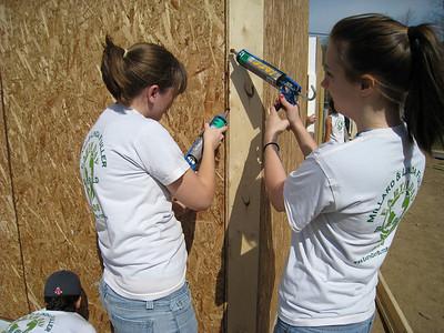 Volunteers from James Madison University work on caulking. lcf
