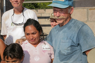 Rubidia Lopez and children Katerine & Michael sponsored by The Schaub family. John Schaub standing tall in the back. ev Charlie Thell at right.