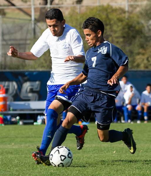 Moorpark College Raider Jose Mora, 7, and a Santa Monica College Corsair during a match at Moorpark College on Fri., Sept. 14, 2012. The match ended in a draw, 2-2.