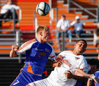 The Fusion's Andy Rose gets a head on the ball over a Fuego defender at the Ventura College Sportsplex on May 1, 2011.