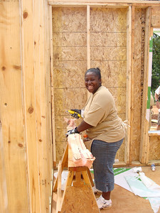 Shakeil McCants (House # 22 sponsored by congregations in the Chattahoochee Valley) is working side by side with volunteers to install insulation in her house.  kl-b