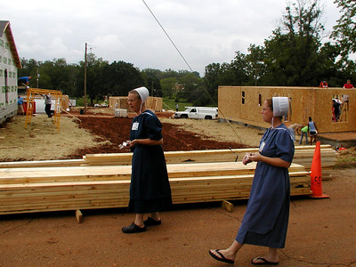 Amish women from Pennsylvania heading to the kitchen to help with food preparation and serving while their husbands so construction type work. Lise Green